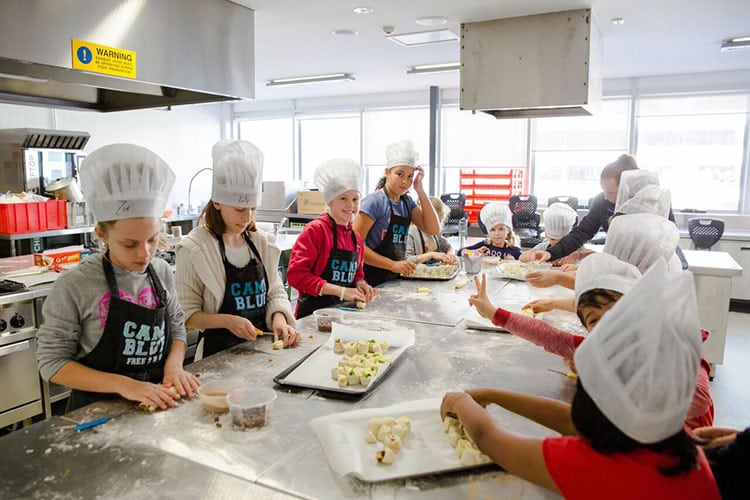 group teenagers baking healthy food