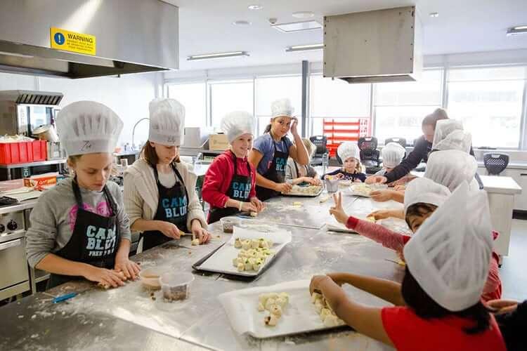 group teenagers baking healthy food