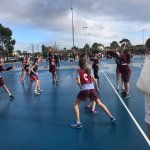 Camp Blue Blog Post image of girls playing netball